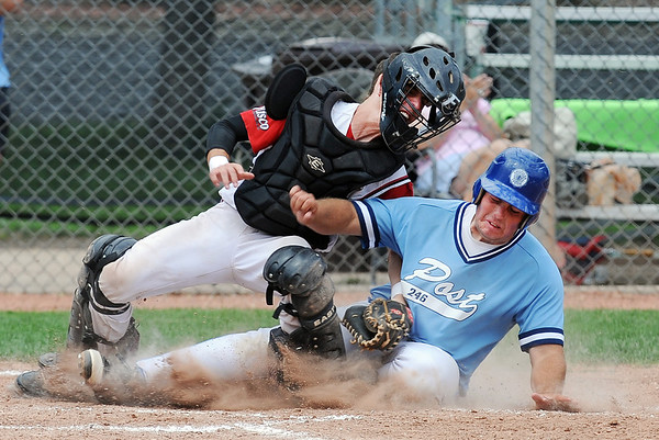 Canon Casey, left, of Fairview, tags outRyan O'Keefe of Moline at home in the first inning of the Boulder NIT championship game on Sunday.<br /> Cliff Grassmick / July 15, 2012