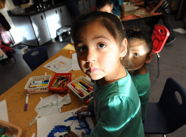 """Maya Gonzalez, left,  and her twin sister, Ruby, work on drawings during a Sanchez after school program, while her aunt and uncle take a parenting class at Sanchez Elementary at the same time.<br /> For a video at Sanchez Elementary, go to  <a href=""""http://www.dailycamera.com"""">http://www.dailycamera.com</a>.<br /> Cliff Grassmick  / December 14, 2012"""