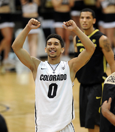 "Colorado Oregon NCAA Men355.JPG Askia  Booker of Colorado, celebrates the 1-point win over Oregon<br /> at  the February 4, 2012 game in Boulder.<br /> For more photos of the game, go to  <a href=""http://www.dailycamera.com"">http://www.dailycamera.com</a>.<br /> February 4, 2012 / Cliff Grassmick"