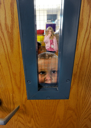"Ryan Garbo, 3, waits to go outside during a Sanchez Elementary after school program, while his mother takes classes at the same school.<br /> For a video at Sanchez Elementary, go to  <a href=""http://www.dailycamera.com"">http://www.dailycamera.com</a>.<br /> Cliff Grassmick  / December 14, 2012"