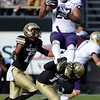 "Colorado Washington Football471.JPG Austin Seferian-Jenkins of Washington goes up high for a catch and is hit by Parker Orms of CU.<br /> For more photos of the CU game, go to  <a href=""http://www.dailycamera.com"">http://www.dailycamera.com</a><br /> Cliff Grassmick / November 17, 2012"