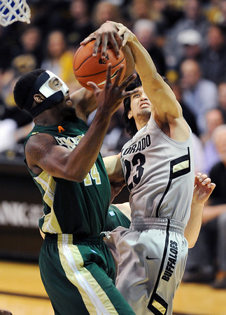 "Colorado CSU Men281.JPG Sabatino Chen of CU blocks the shot of Greg Smith of CSU.<br /> For more photos from CU CSU basketball, go to  <a href=""http://www.dailycamera.com"">http://www.dailycamera.com</a>.<br /> Cliff Grassmick / December 5, 2012"