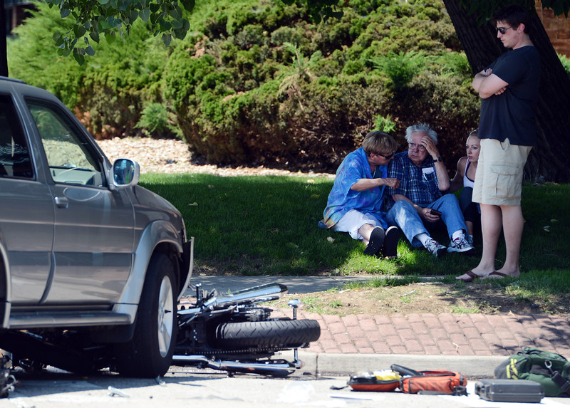 """An accident involving a motorcycle and an SUV at 55th Street and Arapahoe  occurred about 1 p.m. on Friday.<br /> For  a video of the scene, go to  <a href=""""http://www.dailycamera.com"""">http://www.dailycamera.com</a><br /> Cliff Grassmick / July 13, 2012"""