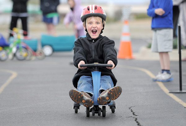 be0415trike02.jpg Kindergartener Isaac Philipsen yells while gliding down the track during the Cross of Christ Preschool Trike-a-Thon on Thrusday as a fundraiser for St. Jude Children's Hospital.<br /> <br /> <br /> April 12, 2012 <br /> staff photo/ David R. Jennings
