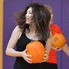 Haley Beaty runs backwards while carrying a pumpkin during the Great Pumpkin Workout at the Paul Derda Recreation Center on Thursday.<br /> October 25, 2012<br /> staff photo/ David R. Jennings