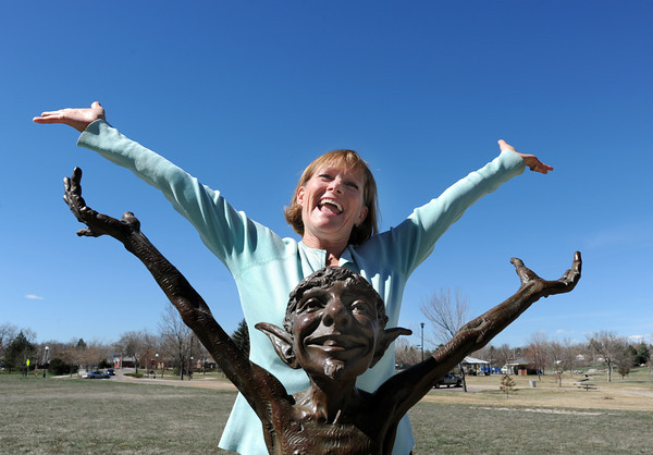 "be0401heart19mil.jpg Fran Milner, Heart of Broomfield Arts winner poses with the the Art for Awhile scupture, ""Green Thumb"" next to the Mamie Doud Eisenhower Public Library.<br /> March 24, 2012 <br /> staff photo/ David R. Jennings"