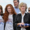 Joan Faughnan, with her family, holds the flag presented to her with her family honoring Chris Faughnan who died eleven years ago in the 9/11 attack during the 9/11 ceremony at the 9/11 Memorial at Community Park on Tuesday.<br /> September 11, 2012<br /> staff photo/ David R. Jennings