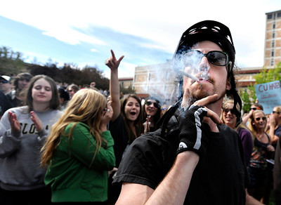 An unidentified man smokes a marijuana cigarette outside of the Duane Physics building during the 4/20 rally on the University of Colorado campus in Boulder on Friday, April 20. For more photos and video go to www.dailycamera.com Jeremy Papasso/ Camera