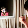 Citlalli Perez-Antillon, 10, applies her makeup during the Celebracion Dia de Muertos celebration on Friday, Nov. 2, at the Rembrandt Yard on 13th Street in Boulder. <br /> Jeremy Papasso/ Camera