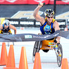 """Scott Parson, of San Jose, Cali., raises his hand in victory after crossing the finish line inside Folsom Field in first place during professional wheelchair race at the Bolder Boulder on Monday, May 28, in Boulder, Colo. For more photos of the race go to  <a href=""""http://www.dailycamera.com"""">http://www.dailycamera.com</a><br /> Jeremy Papasso/ Camera"""