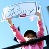 """Cailyn Baldermann, 4, holds up a sign supporting her father Kevin Baldermann as he crosses the finish line inside Folsom Field on the University of Colorado campus on Monday, May 28, during the Bolder Boulder race in Boulder, Colo. For more photos of the race go to  <a href=""""http://www.dailycamera.com"""">http://www.dailycamera.com</a><br /> Jeremy Papasso/ Camera"""