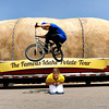 "Tour ambassador Kaiti Frickey cringes as Taylor Bounds, 19, of Broomfield, jumps her with his bmx bike while riding on his lunch break from work in front of the giant potato during The Famous Idaho Potato Tour on Wednesday, April 11, at the King Soopers shopping center on 136th Avenue in Broomfield. For a video about the giant potato truck go to  <a href=""http://www.dailycamera.com"">http://www.dailycamera.com</a><br /> Jeremy Papasso/ Camera"
