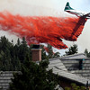 "A heavy tanker drops fire retardant next to a home while fighting the Flagstaff wildfire on Tuesday, June 26, in Boulder. For a video of the fire go to  <a href=""http://www.dailycamera.com"">http://www.dailycamera.com</a><br /> Jeremy Papasso/ Camera"