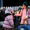 "Celia Reynolds, 6, at right, holds a candle while her sister Julia Reynolds, 3, tries to blow it out on Friday, Dec. 7, at a winter solstice gathering at the Spiral Garden in Boulder. For a video of the Spiral Garden event go to  <a href=""http://www.dailycamera.com"">http://www.dailycamera.com</a><br /> Jeremy Papasso/ Camera"