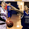 "Centaurus High School's Austin Tunquist gets poked in the eye by Longmont's Brian Donaire while going for a lay-up on Wednesday, Jan. 4, during a basketball game at Centaurus High School in Lafayette. Longmont won the game 46-38. For more photos of the game go to  <a href=""http://www.dailycamera.com"">http://www.dailycamera.com</a><br /> Jeremy Papasso/ Camera"