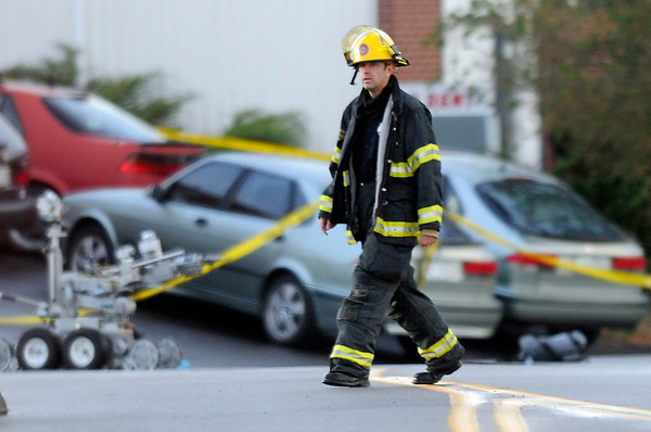 A firefighter walks to his truck after the bomb squad used a robot to detonate a backpack found in a vehicle at the scene of a fatal shooting at a business in the 100 block of Commerce Road in Broomfield on Friday, Oct. 12.<br /> Jeremy Papasso/ Camera