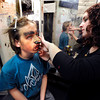 Boulder High School senior Talia Kracauer, right, applies makeup on sophomore Will Hunsaker while creating a werewolf costume on Thursday, Oct. 18, at the Boulder High School Haunted House.<br />  Jeremy Papasso/ Camera