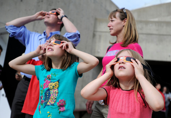 "Leah Pepperdine, right, her mother Carrie Pepperdine, sister josie Pepperdine and father John Pepperdine look through special glasses while observing the Transit of Venus on Tuesday, June 5, at the Fiske Planetarium and Science Center on the University of Colorado campus in Boulder. For more photos and video of the Transit of Venus go to  <a href=""http://www.dailycamera.com"">http://www.dailycamera.com</a><br /> Jeremy Papasso/ Boulder Daily Camera"