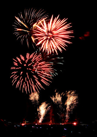 "Fireworks explode in the distance on Tuesday, July 3, during a fireworks display at the Colorado National Golf Course in Erie. For video of the fireworks go to  <a href=""http://www.dailycamera.com"">http://www.dailycamera.com</a><br />  Jeremy Papasso/ Boulder Daily Camera"
