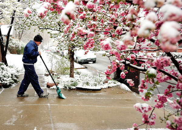 "Bill Booze, of Boulder, shovels snow from his driveway on Tuesday, April 3, in Boulder. For more photos and video of the snow storm go to  <a href=""http://www.dailycamera.com"">http://www.dailycamera.com</a><br />  Jeremy Papasso/ Camera"