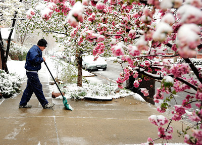 Bill Booze, of Boulder, shovels snow from his driveway on Tuesday, April 3, in Boulder. For more photos and video of the snow storm go to www.dailycamera.com  Jeremy Papasso/ Camera