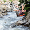 Michael Kodas, of Boulder, uses a cable to cross the upper section of the Boulder Creek on Wednesday, May 30, while heading to climb Cob Rock with a friend.<br /> Jeremy Papasso/ Camera