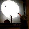 "Devin Clark, 4, of Boulder, points at the Sun while observing the Transit of Venus through the Solar Telescope on Tuesday, June 5, at the Fiske Planetarium and Science Center on the University of Colorado campus in Boulder. For more photos and video of the Transit of Venus go to  <a href=""http://www.dailycamera.com"">http://www.dailycamera.com</a><br /> Jeremy Papasso/ Boulder Daily Camera"