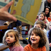 "Emi Heinrich, 2, at left, and her brother Eli, 4, listen carefully as Judy Volc reads a children's book during a story-time session on Tuesday, Jan. 17, at the George Reynolds Branch of the Boulder Public Library in Boulder. Volc has been participating in story-time for 50 years and will soon be dismissed from the volunteer position. For a video interview with Volc go to  <a href=""http://www.dailycamera.com"">http://www.dailycamera.com</a><br />  Jeremy Papasso/ Camera"