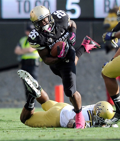 "University of Colorado's Tony Jones rushes the ball during a game against UCLA on Saturday, Sept. 29, at Folsom Field in Boulder. For more photos of the game go to  <a href=""http://www.dailycamera.com"">http://www.dailycamera.com</a><br /> Jeremy Papasso/ Camera"