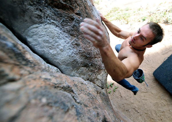 Mitch Rhodes, of Boulder, works on his bouldering skills while climbing Capstan Rock on Flagstaff Road in Boulder on Friday, Oct. 12, in Boulder.<br /> Jeremy Papasso/ Camera