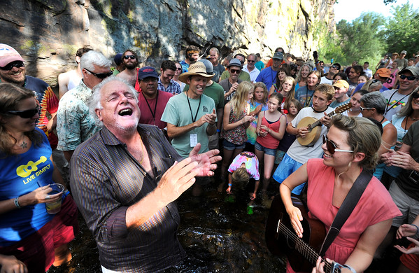 "Grammy Award winning bluegrass musician Peter Rowan, left, and Rocky Grass Academy singing instructor Aoife O'Donovan, right, jam with the rest of the Academy for a christening of newly built instruments in the middle of the river on Thursday, July 26, at the Rocky Grass Academy in Lyons. For more photos and video of the academy go to  <a href=""http://www.dailycamera.com"">http://www.dailycamera.com</a><br /> Jeremy Papasso/ Camera"