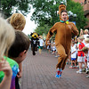 "Ryan Van Duzer, dressed as Scooby Doo, races to the finish line during the mascot race at the Pearl Street Mile on Thursday, Aug. 9, in Boulder. For a video of the race go to  <a href=""http://www.dailycamera.com"">http://www.dailycamera.com</a><br /> Jeremy Papasso/ Camera"