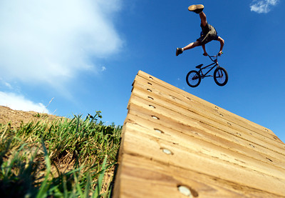 Brian Banghart, of Golden, goes big off a jump at the Valmont Bike Park in Boulder on Thursday, July 12. Jeremy Papasso/ Camera