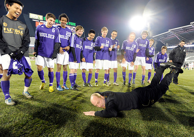 Boulder High School Head Coach Hardy Kalisher does the worm for his team as a kept promise after winning the boys Class 5A State Championship against Smoky Hill High School on Monday, Nov. 12, at Dick's Sporting Goods Park in Commerce City. Boulder won the game 3-1. Jeremy Papasso/ Camera