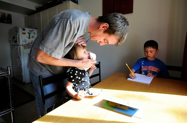 "University of Colorado student and Army veteran Jonathan Wezner wipes his daughter Ashlyn's mouth after eating dinner on Wednesday, April 18, in Boulder. For more photos and video of the life of Wezner go to  <a href=""http://www.dailycamera.com"">http://www.dailycamera.com</a><br /> Jeremy Papasso/ Camera"