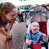 Emily Cooper, of Boulder, left, laughs as her one-year-old son Jonah gets his first taste of ice cream while at the Glacier Home Made Ice Cream & Gelato stand on Thursday, June 7, on Pearl Street in Boulder.<br /> Jeremy Papasso/ Camera