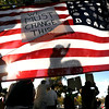 "An american flag with a rally message glistens in the sun on Friday, Oct. 14, during the ""Occupy Boulder"" rally near the intersection of Canyon Boulevard and 26th Street in Boulder. For more photos of the rally go to  <a href=""http://www.dailycamera.com"">http://www.dailycamera.com</a><br /> Jeremy Papasso/ Camera"