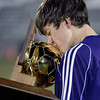 Boulder High School's Benjamin Brown kisses the championship trophy after winning the boys Class 5A State Championship against Smoky Hill High School on Monday, Nov. 12, at Dick's Sporting Goods Park in Commerce City. Boulder won the game 3-1.<br /> Jeremy Papasso/ Camera