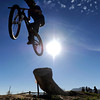 A bicyclist hits a dirt jump on Wednesday, Nov. 7, at the Valmont Bike Park in Boulder. <br /> Jeremy Papasso/ Camera