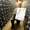 Ronald C. Wittman, associate of the Colorado Museum of Natural History, holds a Lilium Philadelphicum specimen on Thursday, June 28, at the Herbarium on the University of Colorado campus in Boulder.<br /> Jeremy Papasso/ Camera