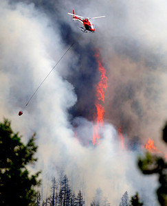 A firefighting helicopter flies above the fire near Bison Drive on Tuesday west of Boulder. Photo by Jeremy Papasso. South Boulder Peak FIre001.JPG