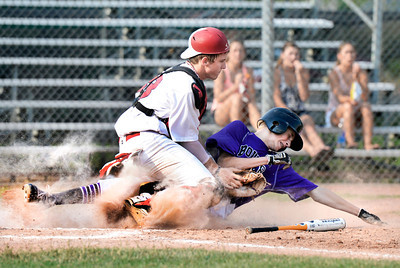 Boulder's Austin Blessing slides into home plate under the tag of Brighton catcher Shane Goldermann on Monday, July 2, during a baseball game against Brighton at the Scott Carpenter Park baseball field in Boulder. Boulder won the game 10-9. For more photos of the game go to www.dailycamera.com Jeremy Papasso/ Camera