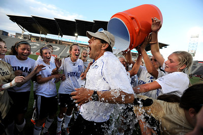 Peak to Peak High School's Alex Johnson, right, dumps cold water on Head Coach Peter Chandler after winning the Class 3A State Championship against Colorado Academy on Tuesday, May 22, at Dick's Sporting Good Park in Commerce City. Peak to Peak won 2-1. For more photos of the game go to www.dailycamera.com Jeremy Papasso/ Camera
