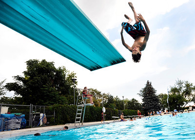 Thomas Hardman, 13, of Rugby, England, does a flip off the diving board on Tuesday, Aug. 7, at Scott Carpenter Pool in Boulder. Jeremy Papasso/ Camera
