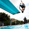 Thomas Hardman, 13, of Rugby, England, does a flip off the diving board on Tuesday, Aug. 7, at Scott Carpenter Pool in Boulder.<br /> Jeremy Papasso/ Camera
