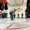 First grade students jump over a bamboo stick while playing a game with physical education teacher Amy Hancock, center, on Tuesday, Jan. 10, at Whittier Elementary School in Boulder. The Boulder Valley School Board is looking into possible solutions to the school's overcrowding problem.<br /> Jeremy Papasso/ Camera
