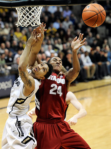 University of Colorado's Askia Booker gets his shot blocked by  Stanford University's Josh Huestis during a basketball game on Thursday, Feb. 23, at the Coors Event Center on the CU campus in Boulder. For more photos of the game go to www.dailycamera.com Jeremy Papasso/ Camera