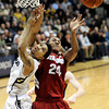 "University of Colorado's Askia Booker gets his shot blocked by  Stanford University's Josh Huestis during a basketball game on Thursday, Feb. 23, at the Coors Event Center on the CU campus in Boulder. For more photos of the game go to  <a href=""http://www.dailycamera.com"">http://www.dailycamera.com</a><br /> Jeremy Papasso/ Camera"