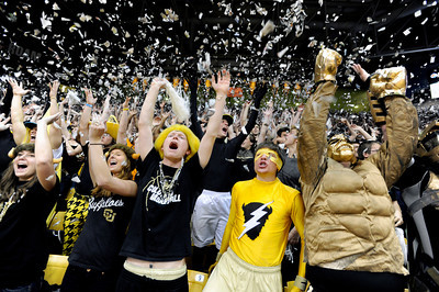 University of Colorado sophomore John Grotenhuis, left, senior Kyle Wolma, center, and sophomore Matt Pitzer throw pieces of newspaper into the air with the rest of the CU student section after CU scored their first two points during a game against Colorado State University on Wednesday, Dec. 5, at the Coors Event Center on the CU campus in Boulder. For more photos of the game go to www.dailycamera.com Jeremy Papasso/ Camera