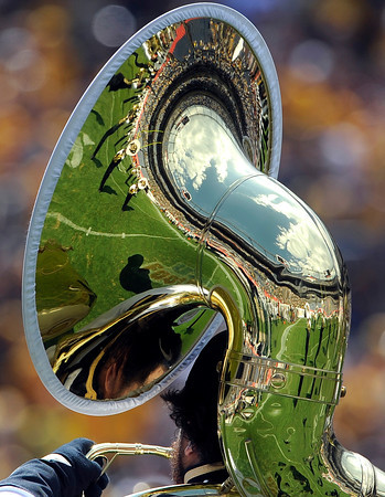 "A reflection of the University of Colorado marching band is seen a a tuba during the Rocky Mountain Showdown against Colorado State University on Saturday, Sept. 1, at Sports Authority Field at Mile High in Denver. For more photos of the game go to  <a href=""http://www.dailycamera.com"">http://www.dailycamera.com</a><br /> Jeremy Papasso/ Camera"